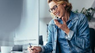 Woman speaking on a speaker phone